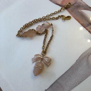 New Tarina Tarantino peach nude skull necklace